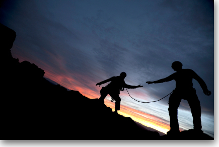 Mountain climber offering a helping hand